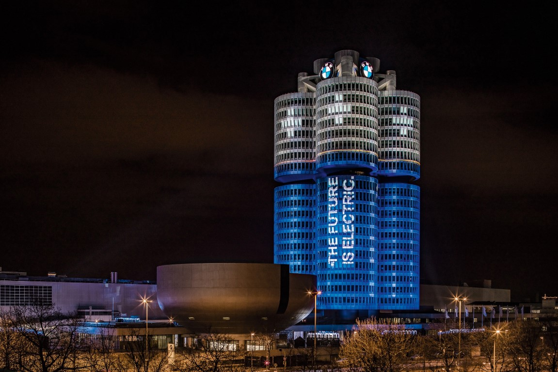 """The BMW Group has delivered more than 100,000 electrified vehicles to customers worldwide in 2017, as promised at the beginning of the year. An eye-catching light installation transformed the BMW Group headquarters, the world-famous """"Four-Cylinder"""" in the north of Munich, on the evening of 18 December 2017 into a battery."""