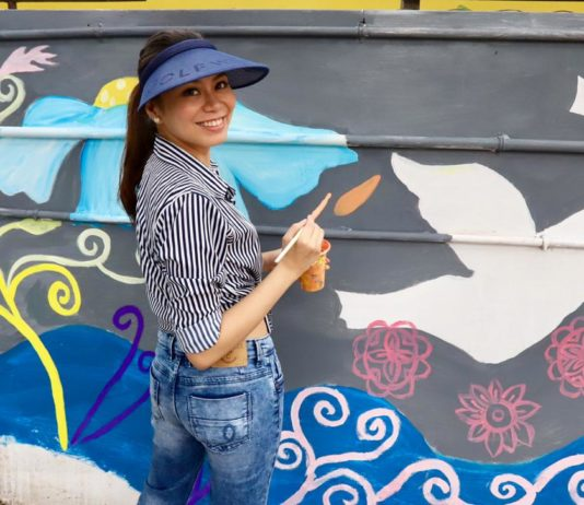 Renowned Filipino Artist paints 100 feet long wall