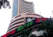 Sensex ends above 49,000